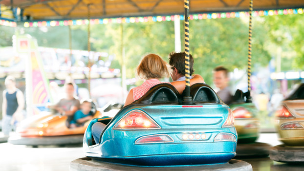senior-couple-in-the-bumper-car-at-the-fun-fair-P2PUSMT-622x350.jpg
